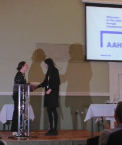 Dina accepting the prize for the best taught postgraduate dissertation of the year at the Association of Art Historian's Annual Conference 2015